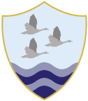 Gosford Hil School shield logo with three geese flying over water